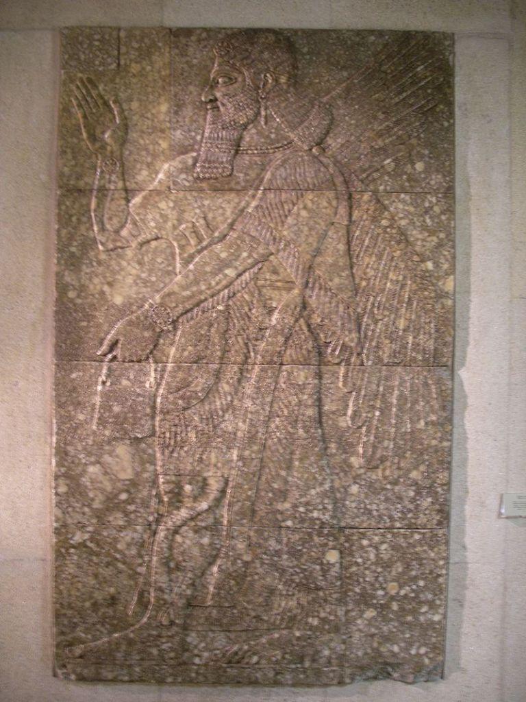Winged genie from the Nimrud palace ofAshurnasirpal II.Museu Calouste Gulbenkian, Lisbon.