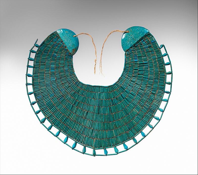 Usekh collar, c. 1981–1975 BC, faience and linen thread.Metropolitan Museum of Art.