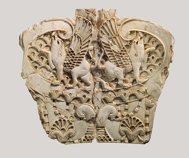 Ivory plaque with two griffins in a floral landscape, Phoenician style.Metropolitan Museum of Art.