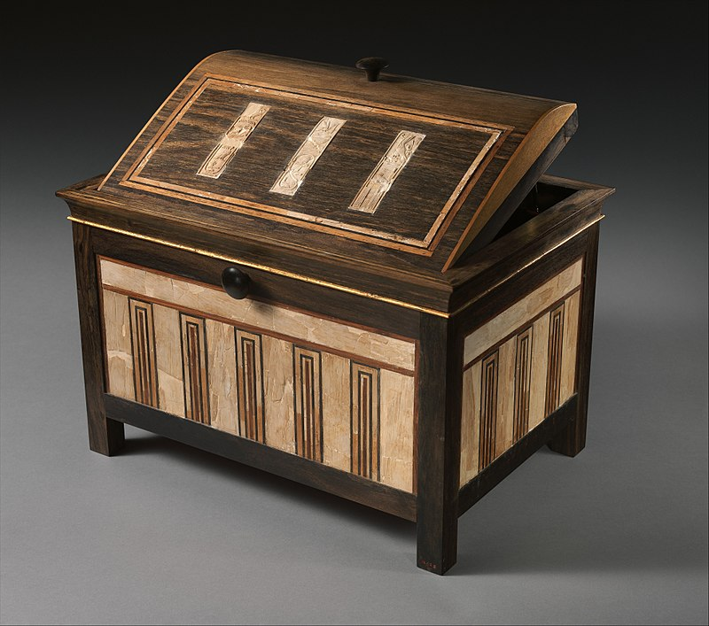 Inlaid box for cosmetic vessels of Sithathoryunet, c. 1887–1813 BC, ebony, inlaid with ivory and red wood (restored) and gold trim. Metropolitan Museum of Art.