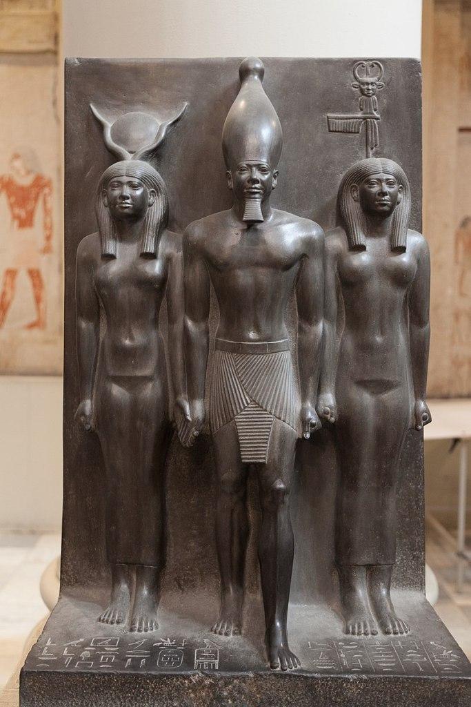 Menkaura flanked by the goddessHathorand the goddessBat. Egyptian Museum, Cairo.