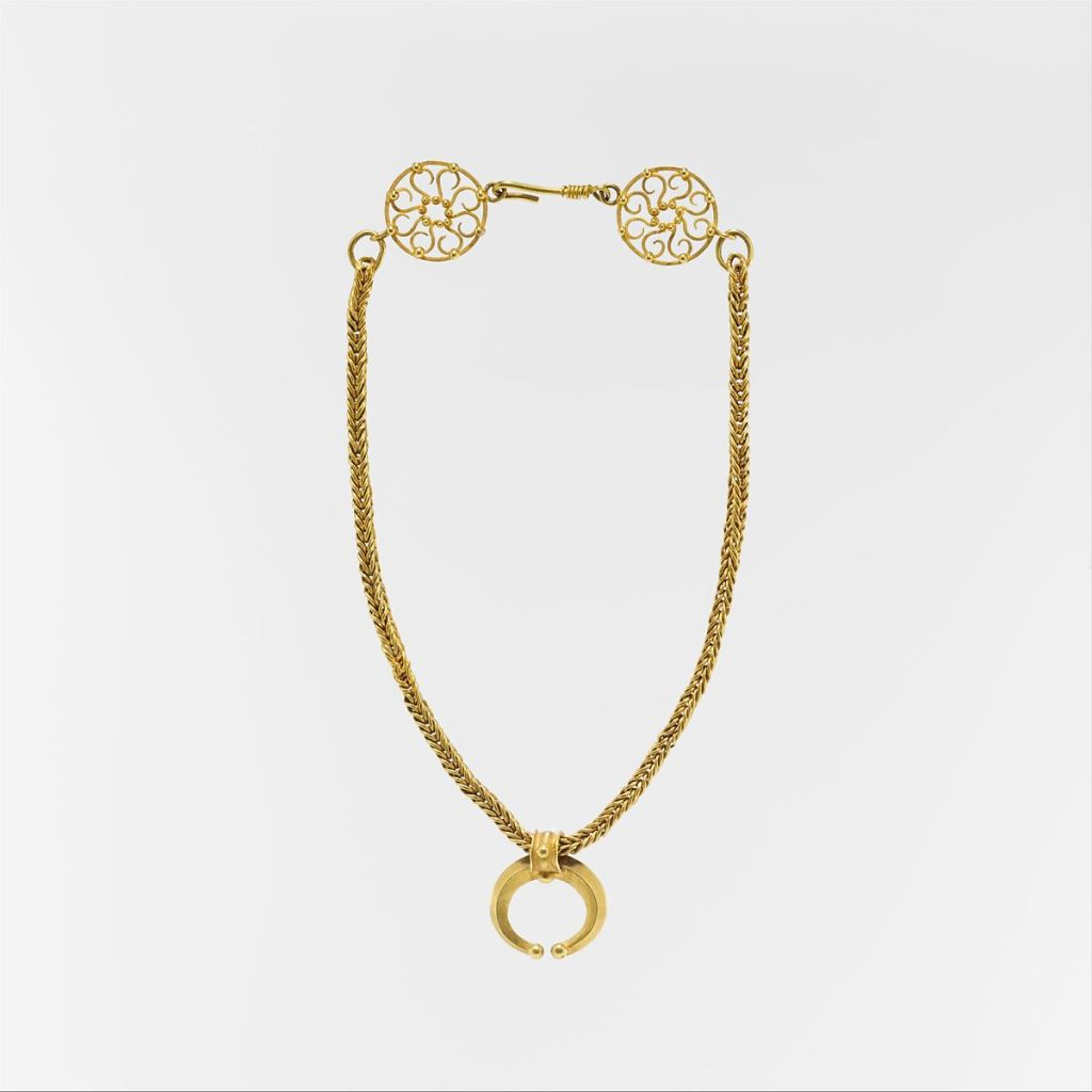 Gold necklace with crescent-shaped pendant, 1st-3rd c. AD.