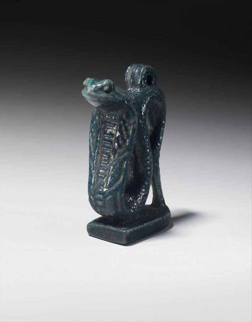 Faience amulet of the goddess Wadjyt as a cobra, 664–332 B.C. Metropolitan Museum of Art.