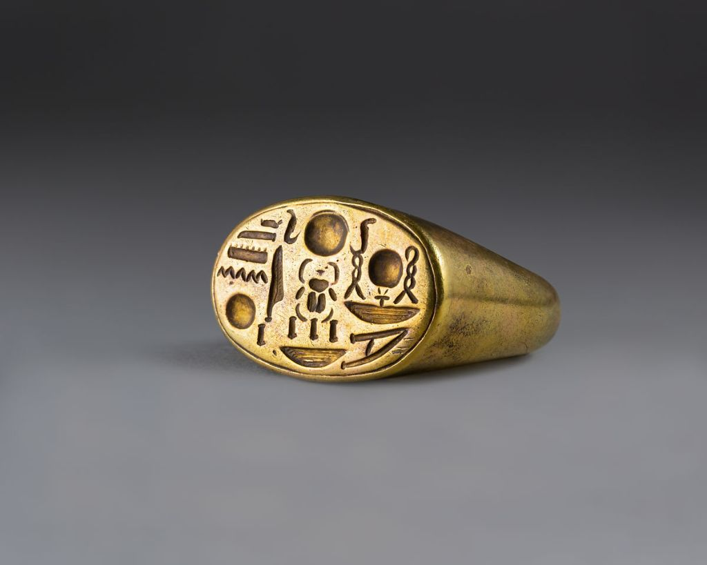 Gold Signet ring with Tutankhamun's Throne Name, c. 1336–1327 BC. Metropolitan Museum of Art.