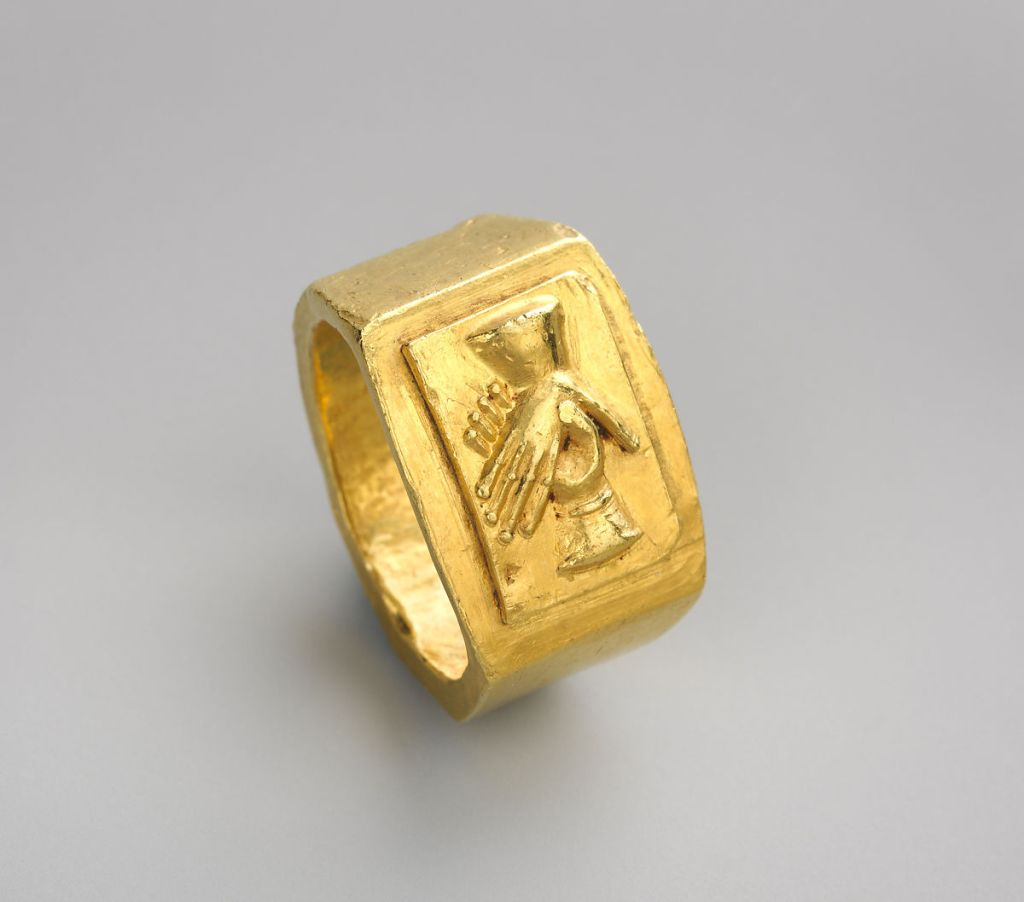 Gold ring with clasped hands, 3rd c. AD. This would have been used as a wedding band.