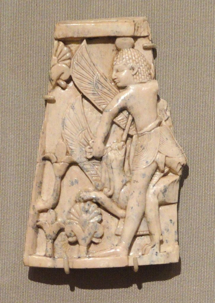 Plaque with man and a griffin in combat.