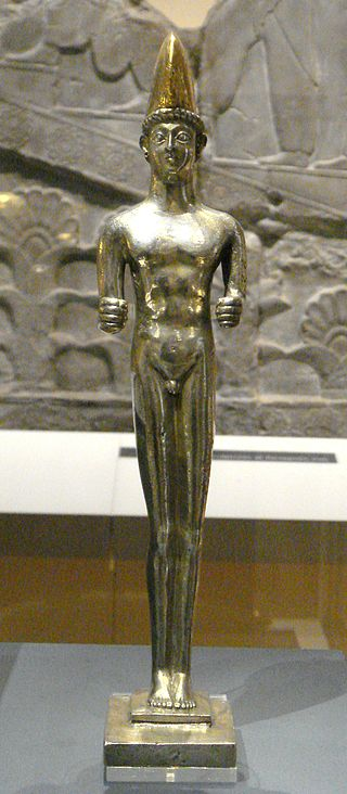 Silver statuette of a naked youth.