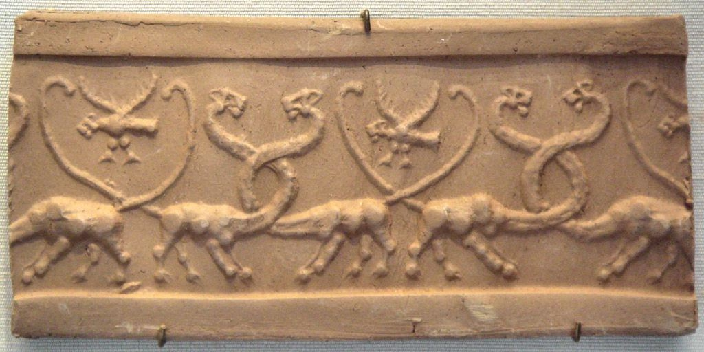 Cylinder seal withserpopards and lion-headed eagles; 4100–3000 BC;jasper.Louvre.